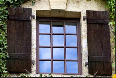Designing the details above for Exterior shutters that look like wood