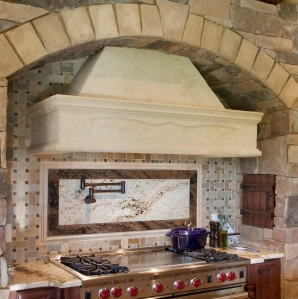 Cast stone range hood in a home designed and built by Florida Custom Builder Jorge Ulibarri
