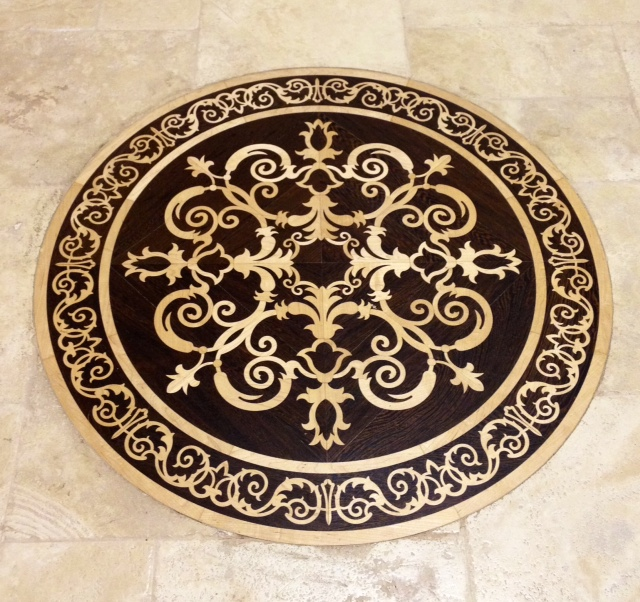 Trade secret 3 to add luxury for less for Wood floor medallion designs