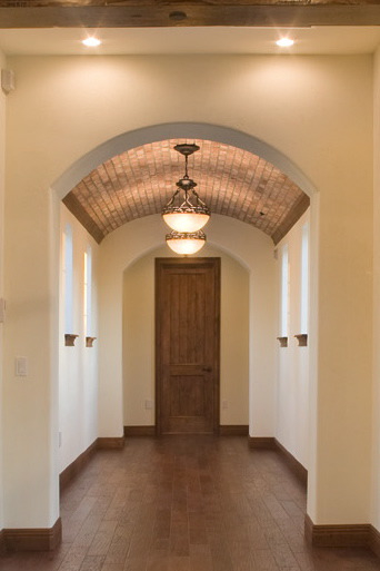 Brick veneer single barrel ceiling in a home designed and built by Orlando Custom Builder Jorge Ulibarri. This single barrel ceiling works well for hallways.
