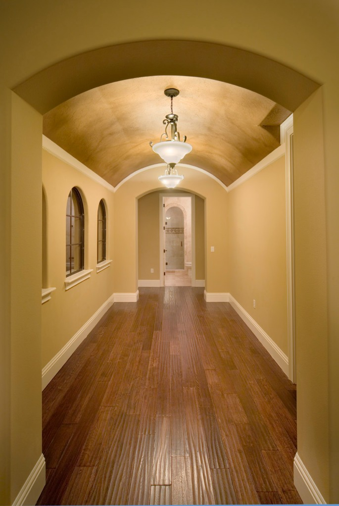 Single faux painted barrel ceiling in the hallway of a home designed and built by Orlando Custom Builder Jorge Ulibarri