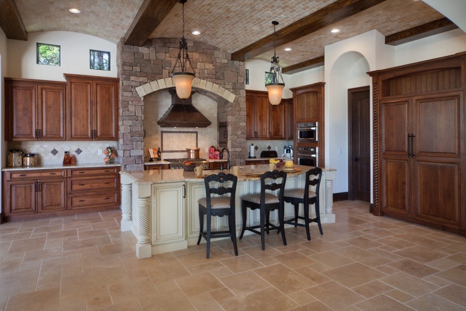 The barrels must align with the kitchen island and lighting fixtures. Pictured here is a brick multibarrel ceiling in a home designed and built by Orlando Custom Builder Jorge Ulibarri